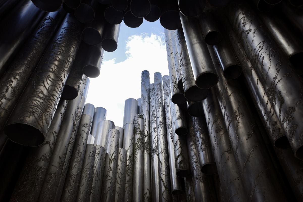 A look towards the sky through the pipes of Sibelius Monument