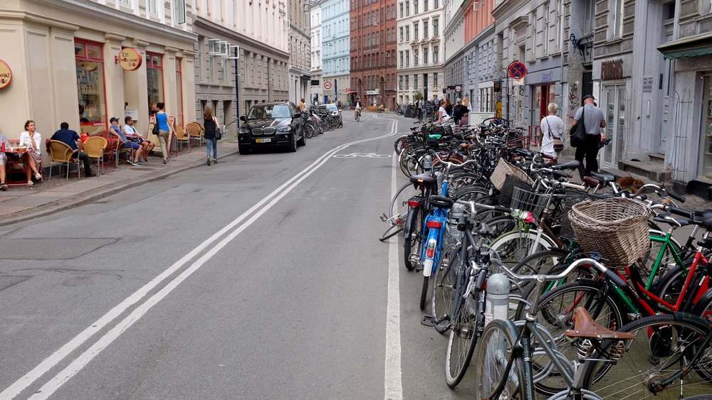A typical Copenhagen street, full of bikes. How can there be some many bikes?